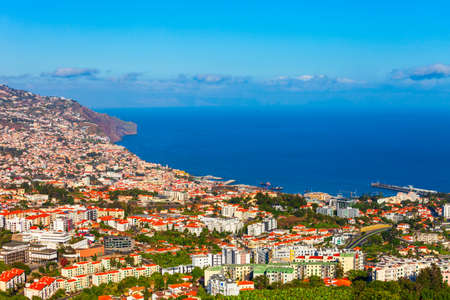 Funchal city aerial panoramic view. Funchal is the capital and largest city of Madeira island in Portugal.
