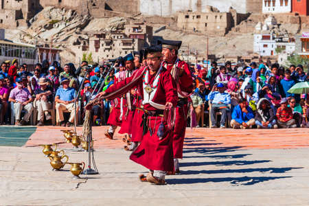 LEH, INDIA - SEPTEMBER 26, 2013: Unidentified people dancing in traditional ethnic clothes at Ladakh Festival in Leh city in India Sajtókép