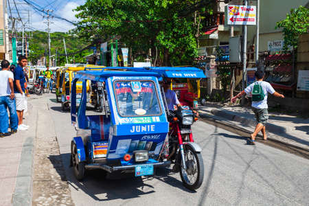 BORACAY, PHILIPPINES - MARCH 04, 2013: Tricycle at the main street in Boracay island. Tricycle is a very popular public taxi transport in Philippines. Editorial