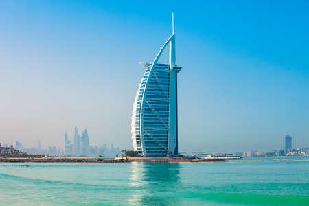 DUBAI, UAE - FEBRUARY 27, 2019: Burj Al Arab luxury hotel and Jumeirah public beach in Dubai city in UAE