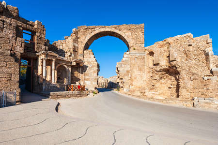 Vespasian fountain and entrance gate of the ancient city of Side in Antalya region on the Mediterranean coast of Turkey.