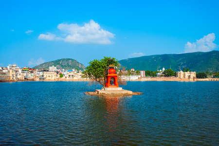 Hindu temple on Pushkar lake in Pushkar in Rajasthan state of India Фото со стока