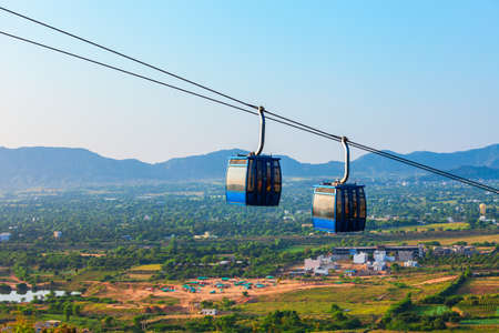 Cable car from Pushkar town to Savitri Mata Temple aerial panoramic view in Rajasthan state of India Фото со стока