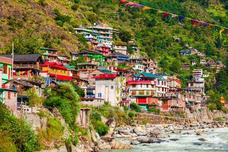 Colorful local houses and Parvati river in Manikaran village in Parvati valley, Himachal Pradesh state in India