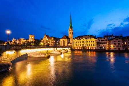 Fraumunster Church and Munsterbrucke bridge through Limmat river in the centre of Zurich city in Switzerland