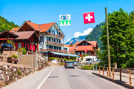 Traditional local houses in Lauterbrunnen village in the Interlaken district in the Bern canton of Switzerland Stockfoto