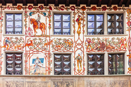 Local houses with paintings at Hirschenplatz main square in Lucerne or Luzern, a city in central Switzerland.