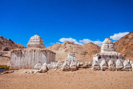 White stupas at the Shey Monastery, a tibetan style buddhist monastery in Shey village near Leh in Ladakh, north India