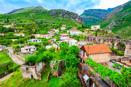 Medieval aqueduct ruins and local houses in the Stari Grad Bar or Bar Old Town, a small town in Montenegro 版權商用圖片