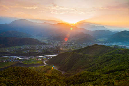 Himalaya hills aerial panoramic view from Sarangkot hill viewpoint in Pokhara city in Nepal at sunrise
