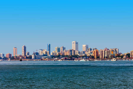 Mumbai city skyline panoramic view from Nariman Point at Marine Drive. Mumbai is a financial capital of India.