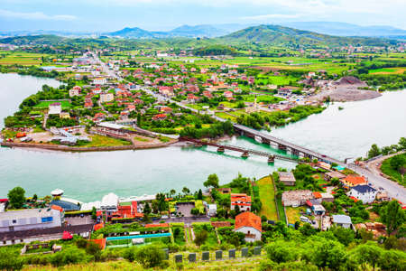 Shkoder or Shkodra town and Buna river aerial panoramic view from Rozafa Castle in Albania