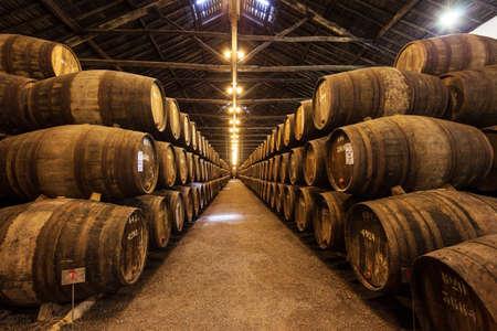 PORTO, PORTUGAL - JULY 01, 2014: Barrels with Porto Wine in the wine cellar in Porto, Portugal