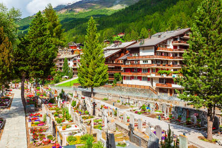 Mountaineers cemetery and traditional local houses in the centre of Zermatt town in the Valais canton of Switzerland
