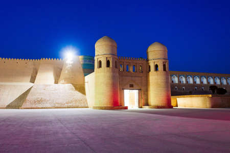 West Gate of the Itchan Kala, an ancient walled inner town of the city of Khiva in Uzbekistan at night Stock Photo