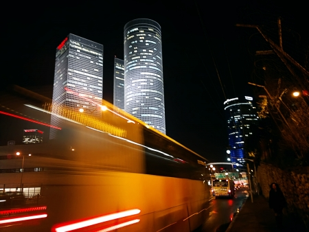 blurred bus in Tel Aviv at night photo