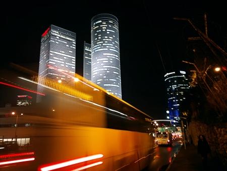 tel: blurred bus in Tel Aviv at night Stock Photo