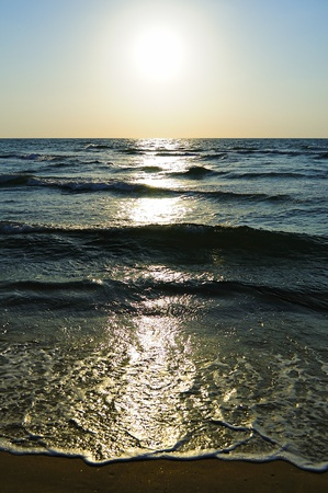 enough: The picture was taken when the sun was still good enough so the waves to get an unusual shine Stock Photo
