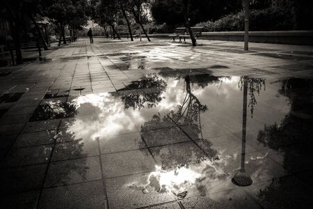 urban landscape, puddle on the pavement Stock Photo