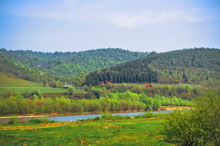 View of the Carpathians, river, hills and houses away