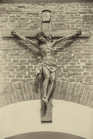 jesus christ on the cross at the entrance to the brick wall of Lviv