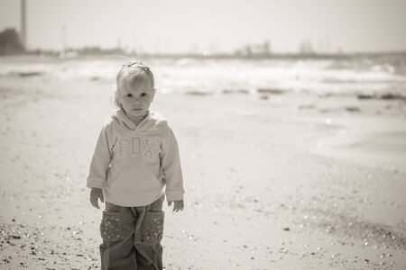 little girl on sea, black and white photo Stock Photo