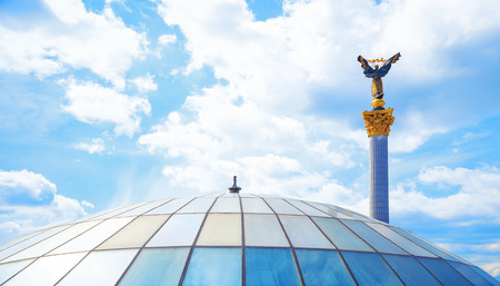 maidan: Glass roof and a statue of independence maidan in Kiev