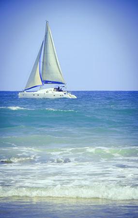 Composition - yacht in sea near the coast
