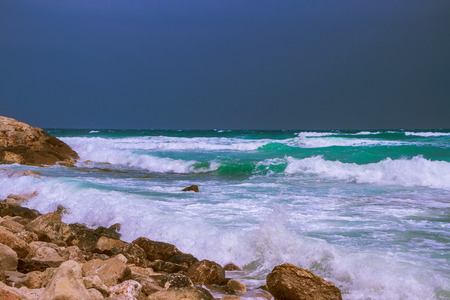 Seascape on the Mediterranean Sea before the storm in the rocky coast Stock Photo