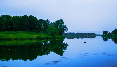 Lake in a beautiful peaceful place in Germany. Evening ore morning Stock Photo
