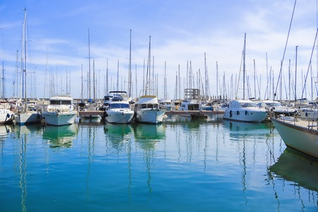 yacht club: Photo of incredible beauty Harbor Yacht Club with glazed clear sea and blue clouds. Italy. Nettuno.