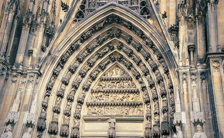 Front facade and old patterns of high and tourism Cologne-Dom