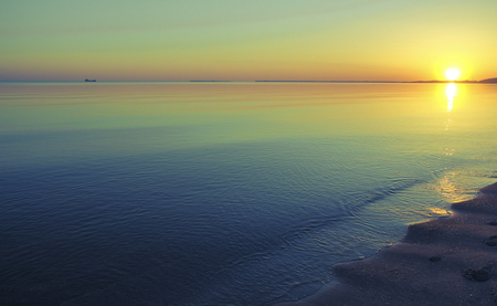 Clear evening sunset on the bay on the Black Sea