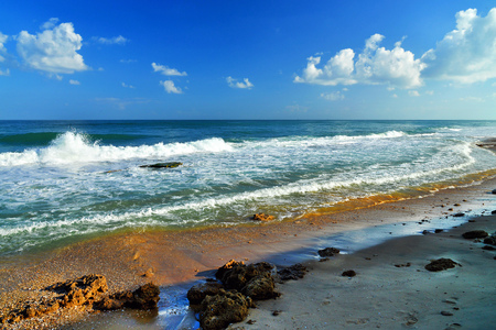 Theme: Seascape cloudy sky big waves and stones Stock Photo