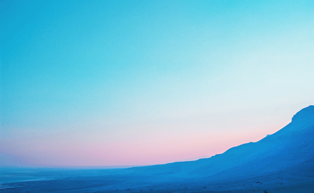 Colorful landscape with blue-pink and cloudless sky in Israel Stock Photo