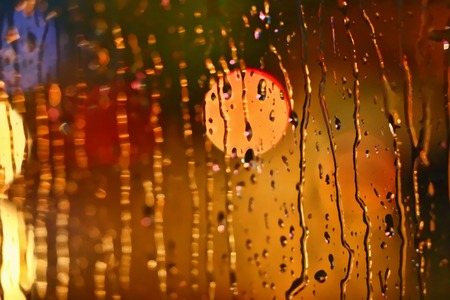 Photos night city made through glass. Street. Rain. Bokeh Lights Out Of Focus. Stock Photo