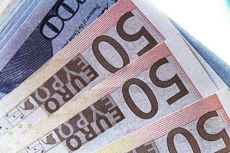 Stock Photo Three bills of 50 euros in the foreground Stopka Money Stock Photo