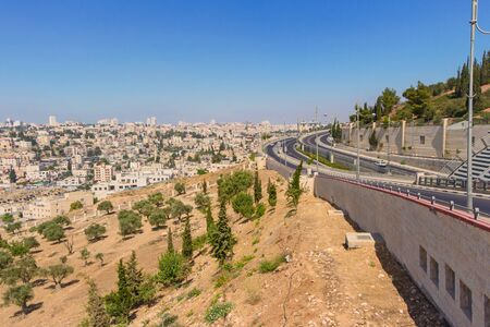Panorama of Jerusalem. Roads. Residential neighborhoods. Slopes with olive trees.