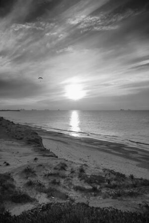 Black and white seascape with the sun in the center