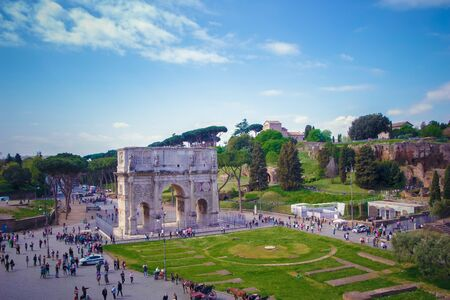 Triumphal Arch of Constantine. Rome. Italy. Photos on the arch, pedestrians and surroundings made with Coliseum. Filming date: April 25, 2015.