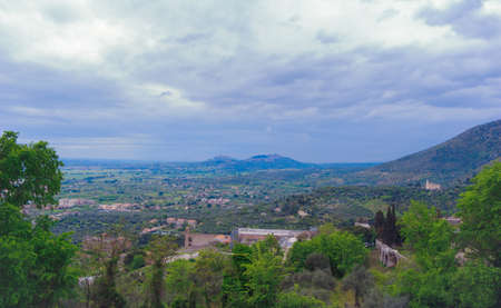 The breathtaking landscapes of Italy. Panoramic view Gregorian villa surroundings against the background of an ensemble of clouds