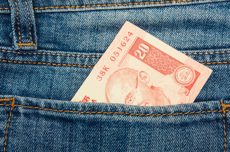 Old series Indian rupee currency, money in jeans pocket with copy space Stock Photo