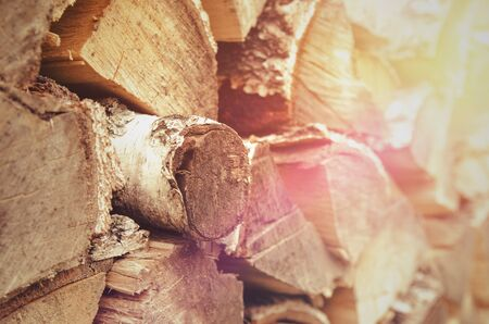 the woodpile of firewood sunset