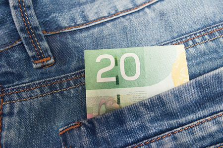 Canadian Dollar in a jeans pocket Stok Fotoğraf - 81785095