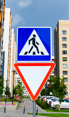 building regulations: Pedestrian crossing sign on the buildings Stock Photo