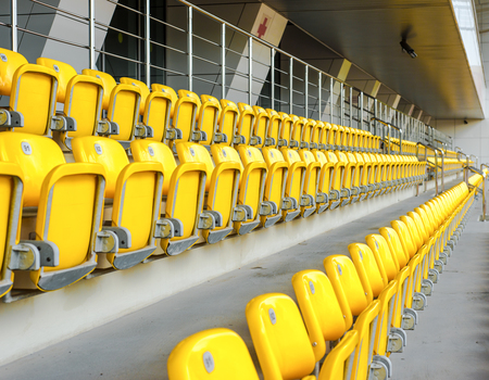 Empty yellow stands of the stadium