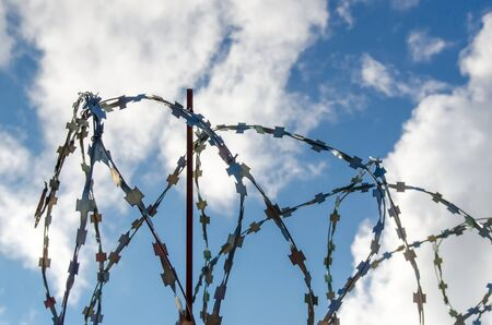 barbed wire on the sky background Stock Photo