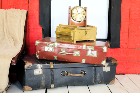 Many suitcases and watch