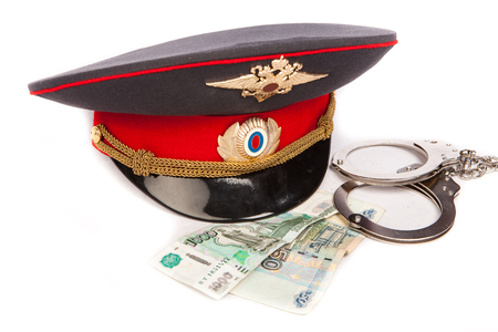Police, russian money and handcuffs Stock Photo