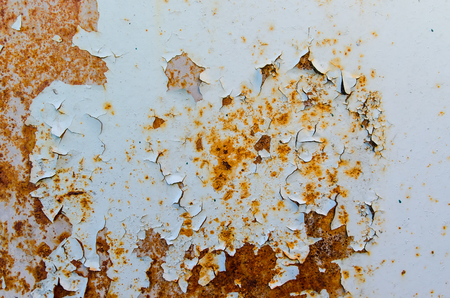 Texture of rusty metal with peeling blue paint